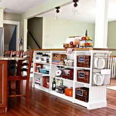 Bloggers Courtney and Bill Affrunti chronicle their DIY home-transformation adventures at goldenboysandme.com including this kitchen island fabricated from prefab IKEA bookcases. | thisoldhouse.com
