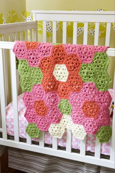 Bright Flower Throw - Lion Brand  Super easy pattern, I used Mulberry instead of Goldfish, Sweet Pea Pink, and everything else was Fern Green.