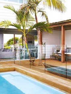 pool, timber, palm trees beautifully landscaped outdoor living space