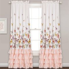 This beautiful piece will brighten any little girl's room. With a colorful array of graceful butterflies fluttering atop gorgeous pink ruffles, this set of room darkening curtains is fit for little princesses everywhere.