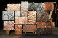 Hand hammered copper wall panel that is tall and and one inch thick. The copper panels are 18 gauge thick hammered with a liver of sulfur fini…