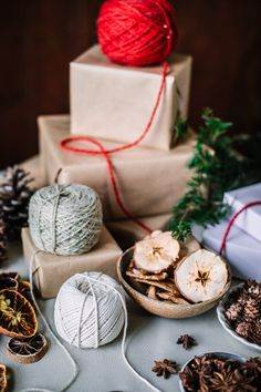 Simple ideas for natural and sustainable gift wrapping for the holidays, using just brown kraft paper, dried fruit, natural textiles, and foraged pieces. Cozy Christmas, Christmas Gifts, Sustainable Gifts, Christmas Gift Wrapping, Kraft Paper, Winter Holidays, Earthy, Wraps, Candles