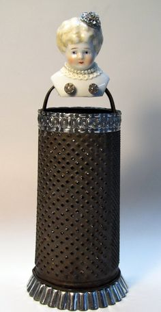Art doll made from a vintage grater, vintage porcelain doll head, junk, antique buttons and tart tin Vintage Porcelain Dolls, Found Object Art, Grater, Assemblages, General Crafts, Assemblage Art, Doll Head, Altered Art, Art Dolls