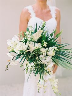 These are the best beach wedding bouquets from real weddings. From tropical flowers to classic blooms in unexpected hues, here's how to create the ultimate bouquet for your beach wedding. Tropical Wedding Bouquets, Beach Wedding Flowers, White Wedding Bouquets, Floral Wedding, Tropical Weddings, Bridesmaid Bouquets, Tropical Flowers, Bridal Bouquets, Ranunculus Wedding Bouquet