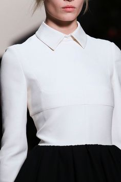 Elegance in Simplicity - minimal white buttonless blouse with sharp collar detail // Valentino