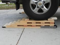 Ramps - Homemade ramps constructed from 2x10s. Wheel-mounted for enhanced mobility.