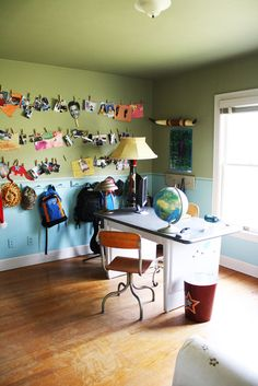 Love the clothesline of photos and the area to hang up backpacks!