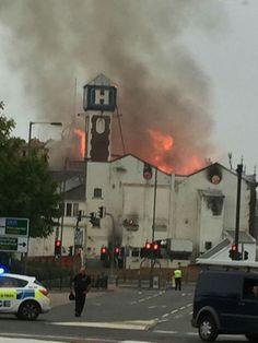 The old co-op buildings in flames