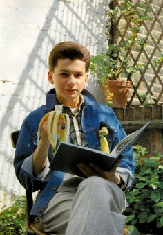 Dave Gahan of Depeche Mode eating a banana