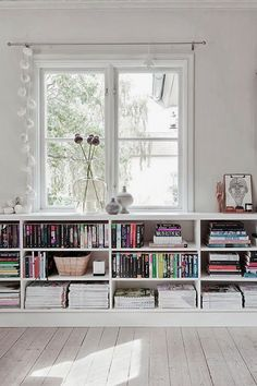 Classic Living Room Design Ideas with White Walls and Half Bookshelf