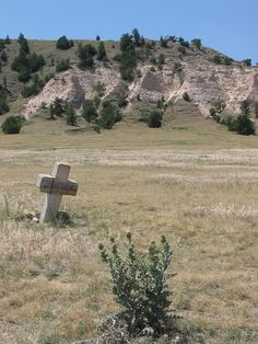 "Lonely grave along the Oregon trail reads ""Dunn, 1849""."