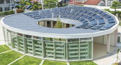 """Meet the Donut-shaped art Museum, The """"Komodo Art Maison"""" children's center's topped with solar panels and provides space for a library and community rooms."""