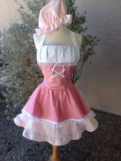 This is an adult size Little Bo Peep costume apron. Made of cotton.The skirt is a wrap style that provides full coverage in back yet is adjustable to fit
