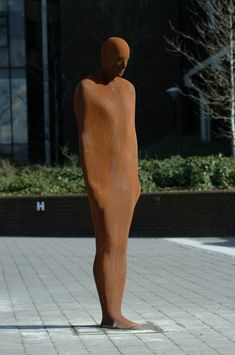 This unique cast iron sculpture by Antony Gormley is called Together and Apart. The students often refer to him as Brown Thomas and he features regularly in graduation portraits.