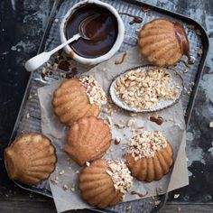 Gorgeous nutty hazelnut madeleines, dipped in salted whiskey caramel and crushed nuts.