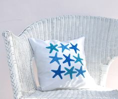 starfish in ocean blue and turquoise, on white organic cotton nautical pillow cushion cover via Etsy.