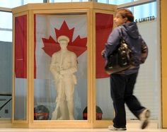 A restored cenotaph soldier stands in a display case inside the Woolwich Memorial Centre on Sunday.