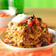 Mexican Lasagna Recipe -I collect cookbooks and recipes (this one is from my son's mother-in-law). My husband teases me that I won't live long enough to try half of the recipes in my files! —Rose Ann Buhle, Minooka, Illinois