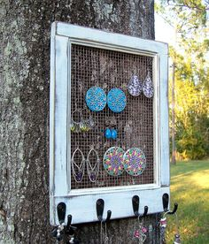 A frame with some wire netting and a few hooks is perfect for lots of jewelry storage - MyHomeLifeMag.com