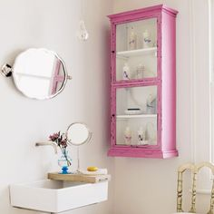"Idea....paint medicine cabinet a different ""pop"" color."