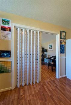 One of the most interesting principle behind accordion doors is that they are seldom made use of as actual entryways as well as exits. Most of the time, these folding barriers are made . Read Best Accordion Doors Ideas for Your House Room Divider Doors, Diy Room Divider, Room Divider Curtain, Divider Ideas, Interior Door, Interior Design Living Room, Acordian Doors, Accordion Folding Doors, Diy Folding Doors