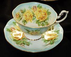 ROYAL ALBERT RAINBOW GRAND PEDESTAL TEA CUP AND SAUCER YELLOW ROSE