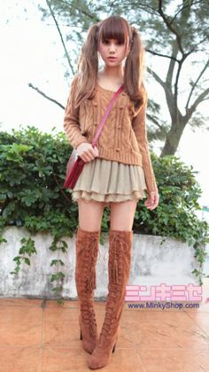 Cute, gyaru: Red bag. Light brown, cable knit cardigan. Olive, pleated chiffon skirt. Thigh-high brown boots with heels.
