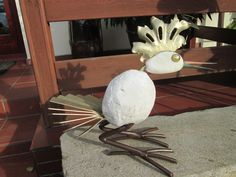 the bird made of white marble, steel, copper and glass