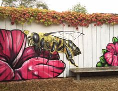 I spent my Sunday morning painting a bee on the fence of a local community centre.
