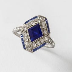 Art Deco Diamond and Sapphire Ring  An Art Deco platinum ring with blue sapphires, and diamonds.  Circa: 1920's