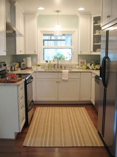 My ideal kitchen...add a little more counter space there on the left next to the stove and call it a dream.