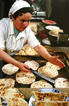 Cooking Piadina, Italian flatbread, typically prepared in the Romagna region