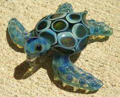 Not sure if this is a bead, pendant or just an ornamental piece, but this lampwork glass turtle is really cute!