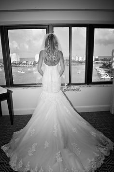 Photo by Michelle Lawson Photography. Absolutely beautiful black and white photo of my Maggie Sottero wedding dress ♥ Behind the scenes pic of getting dressed! #wedding #weddingideas #gettingdressed #weddingdress #behindthescenes #weddingdressideas #mstriciasfl #gettingready #blushweddingdress #pinkweddingdress #MaggieSottero #designerweddingdress #blackandwhiteweddingphotography #laceweddingdress