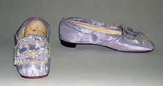 Wedding Slippers    Date:      1860  Culture:      American  Medium:      silk, leather  Dimensions:      Length: 8 3/4 in. (22.2 cm)  Credit Line:      Gift of The Misses Mary L. and Katherine Gardner, 1958