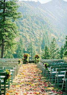love how they used leaves to line the aisle for this fall wedding