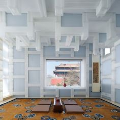 Kengo Kuma replaces the walls of a Beijing tea house with a grid of translucent blocks