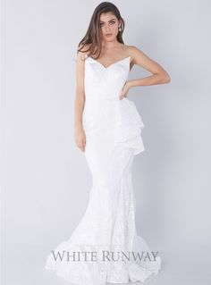 Charlize Gown. A gorgeous bridal gown by Jadore. A strapless style featuring an edgy pointed neckline, ruffle detailing on the waist and fishtail hem.