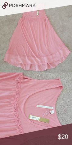NWT Lauren Conrad light pink tunic tank, S NWT Lauren Conrad light pink, very soft jersey material,  flowey long tunic tank top with silky border on bottom. Longer in back to cover the bottom, super cute with leggings. This is a re-posh: I Love this tank but unfortunately it is way too big for me. Sized as a small but fits more like a large I would say. NEVER worn Lauren conrad Tops Tank Tops