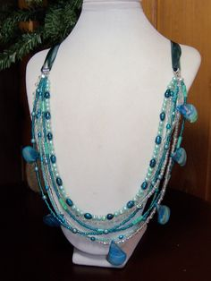 CULTURED PEARLS, GLASS PEARLS, MOTHER OF PEARL, SEED BEADS, RIVERSTONE WITH ORGANZA RIBBON....MAGNETIC CLASP NECKLACE
