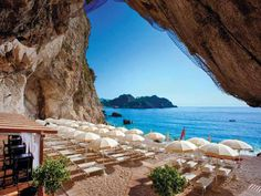 Capotaormina private hotel beach in Sicily,  Italy. An amazing hotel built into the rock face with a series of underground caves, so beautiful.