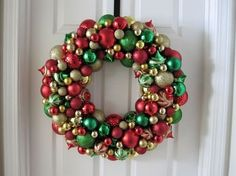 Christmas wreath using ornaments, hot glue, and a wire wreath form