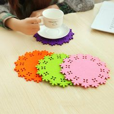 Round shape wool felt coaster. Various colors and hollow design to decorate and desk and protect the table surface.