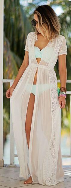 Shop this look on Lookastic:  https://lookastic.com/women/looks/beach-dress-bikini-top-bikini-pant-sunglasses-bracelet-bracelet-bracelet/11767  — Black Sunglasses  — Light Blue Bikini Top  — Light Blue Bikini Pant  — Brown Beaded Bracelet  — Mint Beaded Bracelet  — Pink Beaded Bracelet  — White Lace Beach Dress