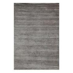 "Stylishly anchor your living room or master suite with this handsome wool and art silk rug, showcasing a distressed gray motif.   Product: RugConstruction Material: Wool and art silkColor: GrayFeatures: Hand-loomedPile Height: 0.285"" Note: Please be aware that actual colors may vary from those shown on your screen. Accent rugs may also not show the entire pattern that the corresponding area rugs have.Cleaning and Care: Vacuum regularly. Do not saturate rug with water. Use only cold water ..."