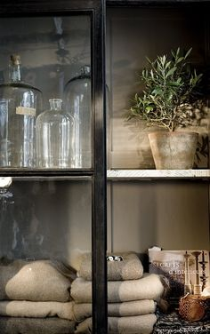 Chic Modern Country Cabinet.....styling details so beautiful....great place to keep sweaters & collectibles too.