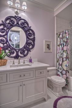 Add a pop of color by painting the bathroom mirror a bright, fun color! Adorable bathroom.