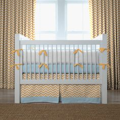 Light Orange and Aqua Chevron Crib Bedding | Carousel Designs #BabyGirl #CarouselDesigns