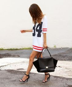 Super Bowl Style - How to Make a Sports Jersey Look Chic - oversized mens jersey as a dress, worn with sexy heels and a black leather bag