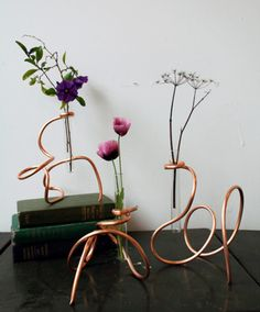 DIY copper wire vase accessory- these look great in a small group or as individual accents.